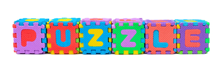 PUZZLE shaped by alphabet jigsaw puzzle on white