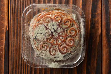 moldy moon cake on wooden background