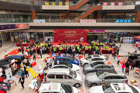 ZhongShan China-Jan 20,2019:People writing Chinese new year scrolls and looking live show in a shopping mall.