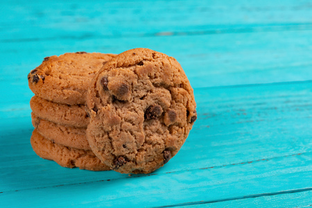 stack of sweet cookies on blue background Stock Photo