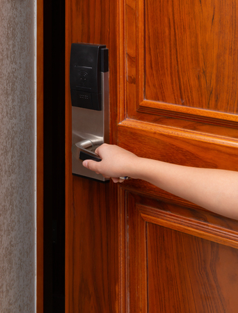 boy opening a door with electronic lock