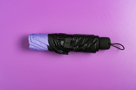 foldable umbrella on a lilac background