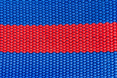 blue and red woven harness close up as background and texture