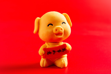 a yellow cute pig mascot for the new year 2019 on red background translation for the Chinese in English is everything is as good as wishes