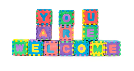 YOU ARE WELCOME shaped by alphabet jigsaw puzzle on white