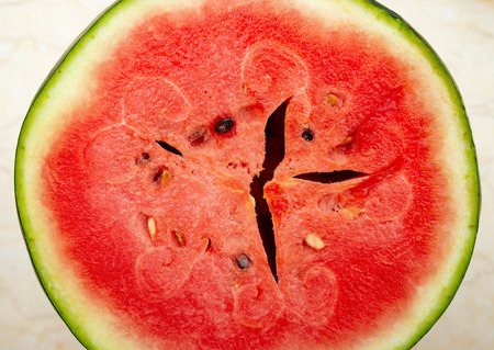 cut out section of an overripe watermelon as background and texture