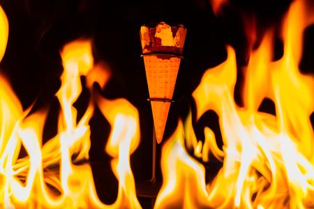 ice cream cone inside fire Reklamní fotografie