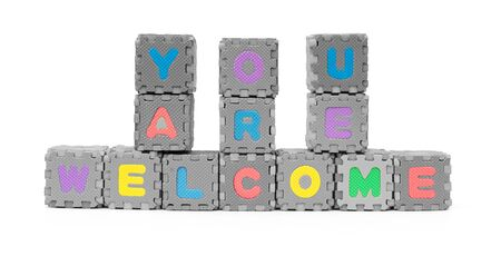 YOU ARE WELCOME shaped by alphabet jigsaw puzzle on white Stock fotó