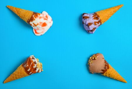 ice cream cones in a melting process on a blue background