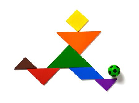 tangram shaped as a player  dribbling a soccer on white background