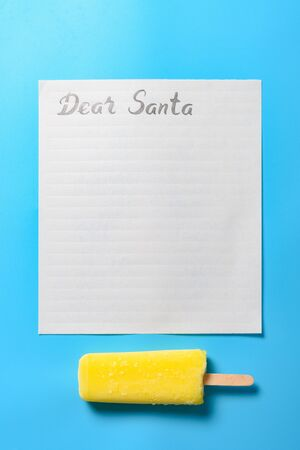 letter paper with hand written Dear Santa and a ice-cream Stock Photo