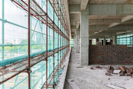 inside of an unfinished building with protection scaffolding and netting surrounde