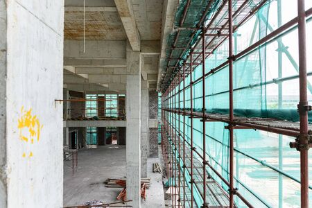 inside of an unfinished building with protection scaffolding and netting surrounded
