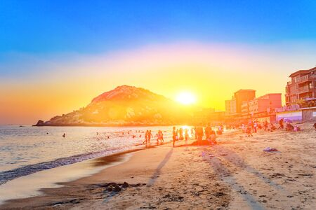 beach with soft wave in sunset time with beautiful sunlight