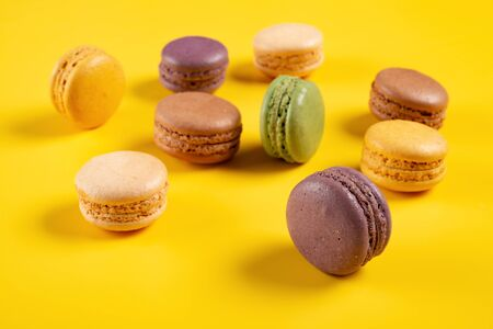 colorful macaroons on a yellow background