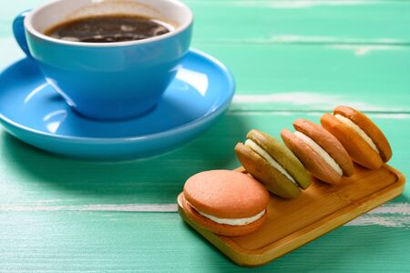 side view multi-color macaroon and cup of coffee horizontal composition 写真素材
