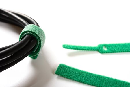 green cable tie and cable on white