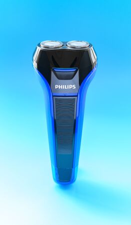 ZhongShan China-February 22;2020:electric shaver on a blue background.