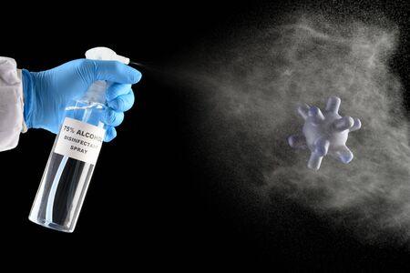 spraying 75 percent alcohol disinfectant alcohol to coronavirus on black background