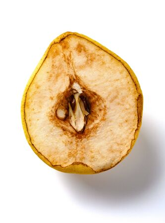 cut out section of an overripe pear on white background 版權商用圖片