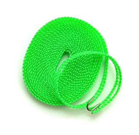 top view green plastic clothesline on white