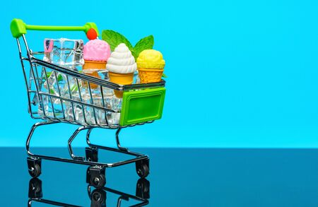 shopping cart with ice cream cones and ice cubes