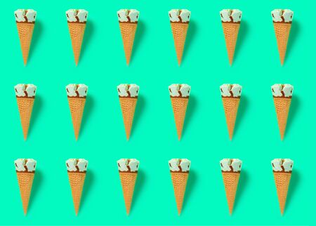 rows of fresh hami melon and oats flavor ice cream cones on green background