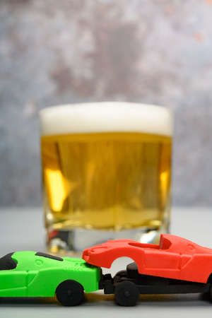 car accident with cup of beer at background concept of drunk driving no logo no trademark Foto de archivo