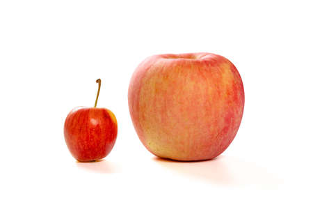 a small apple and a giant size one on a white background Banque d'images