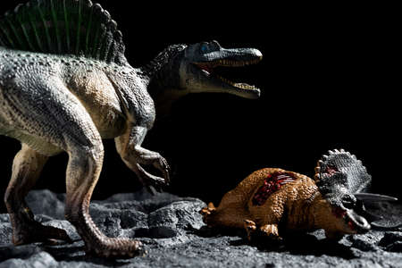 spinosaurus with a triceratops body on a ground with craters Reklamní fotografie