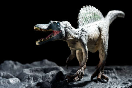 spinosaurus on a ground with craters