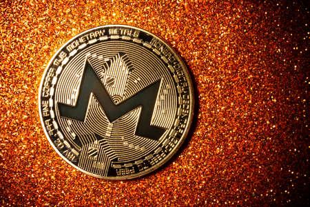 Monero coin on a dark background close up