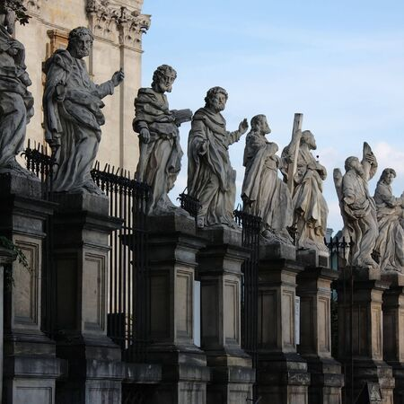 A side view of the statues of the 12 apostles in front of the Sts. Peter and Pauls church in Krakow, Poland. Stock Photo