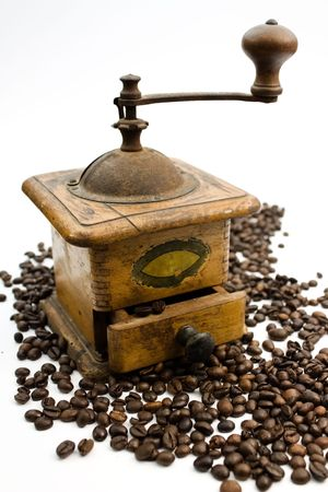 A close up of an antique coffee grinder and beans. Stock Photo