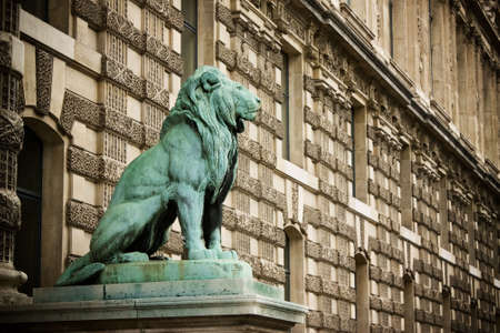 Lion statue outside the Louvre museum in Paris, France. Stock Photo