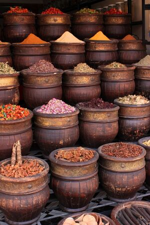saffron: A spice vendors display, powdered spices in large wooden bowls. Stock Photo