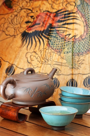 An Asian tea set on a colorful background. Editorial