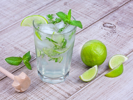 Mojito cocktail on wooden background