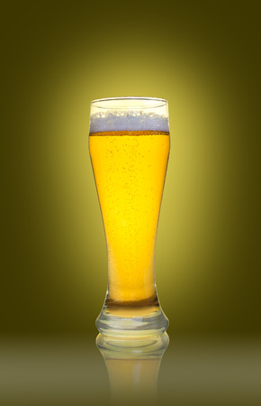 real ale: Glass of beer isolated on yellow background Stock Photo