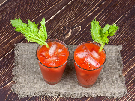 Bloody mary cocktails  on wooden background