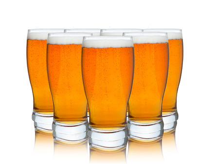 real ale: Glasses of beer isolated on a white background