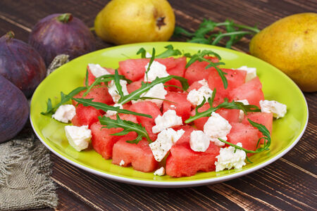 Watermelon, cheese and rocket salad photo