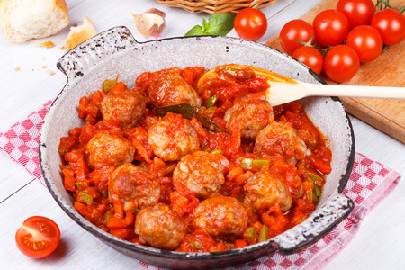 Meatballs with tomato sauce in a pan photo