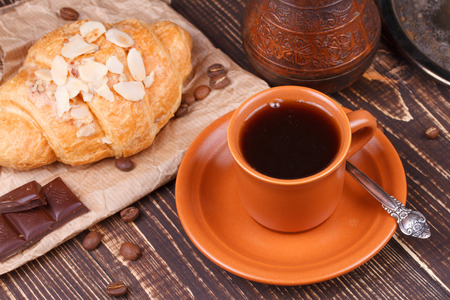 Coffee cup and croissant photo