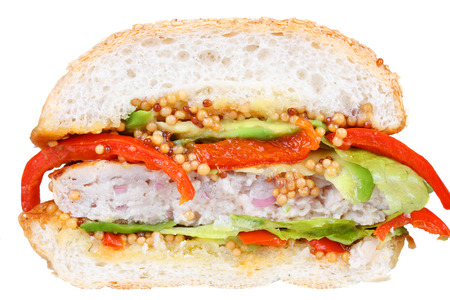sesame seed bun: Burger with turkey, avocado, lettuce, onions, red paprika pepper on a sesame seed bun. Isolated on white background