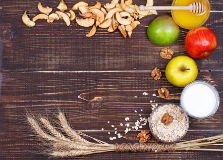 Apple Chips, Fresh Apples, Honey, Milk, Oat Flakes and Walnuts. Still Life.