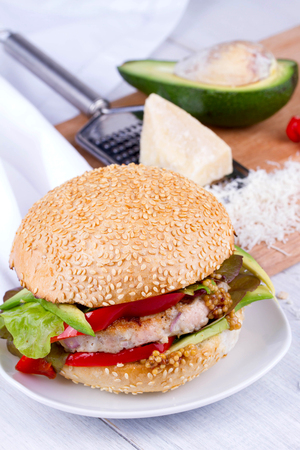 home cooked: Home cooked burger with turkey, avocado, lettuce, onions, red paprika pepper on a sesame seed bun