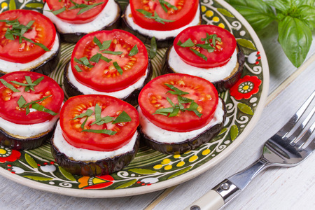 parmezan: Grilled eggplant with spicy sour cream sauce, tomatoes and basil