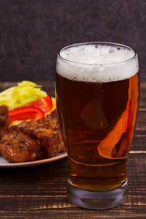 real ale: Glass of Beer, Pork Ribs and Vegetables Stock Photo