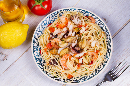 Seafood and Tomato Spaghetti. View from above, top studio shot Stock Photo